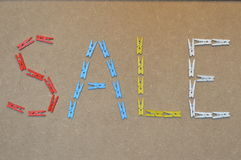 Sale written with clothes pins Royalty Free Stock Photo