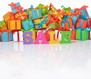 Sale written by colorful letters on the background of gifts Stock Photos