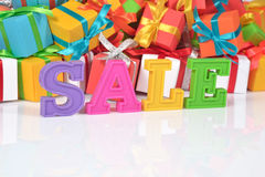 Sale written by colorful letters on the background of gifts Royalty Free Stock Photo