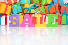 Sale written by colorful letters on the background of gifts Stock Photo