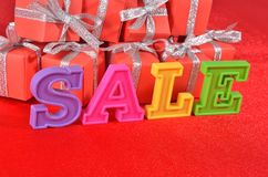Sale written by colorful letters and gifts Royalty Free Stock Photography