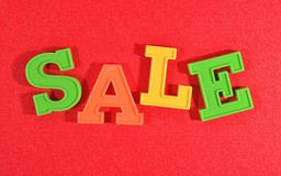 Sale written by colorful letters on a red Stock Photography