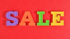 Sale written by colorful letters on a red Royalty Free Stock Photography