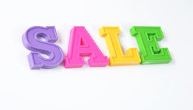 Sale written by colorful letters on a white Royalty Free Stock Photos