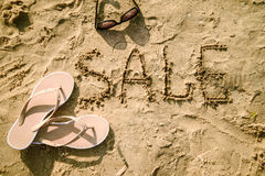 Sale written in the sand on a beach Stock Image