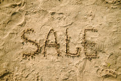 Sale written in the sand on a beach Stock Photo