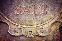 Sale written on stucco wall - concept image stock images