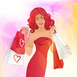 Sale: Young pretty woman with shopping bags. Beautiful redhead woman with shopping bags Stock Photo