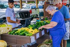 At the Salem Farmers Market. Salem, Virginia USA – July 28th: Elderly couple shopping at Salem Farmers Market on a Saturday morning located in downtown Salem Royalty Free Stock Photography