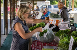 Salem Farmers Market. Salem, VA – June 10th: Customer buy vegetables at the Salem Farmers Market located downtown Salem, Virginia, USA on the 10th June 2017 Stock Photo