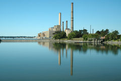 Salem Harbor Power Plant. In Salem, MA, reflected in the quiet waters of a harbor off Winter Island stock photography