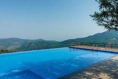 Salem,Yercaud,India, April 29 2017: swimming pool on top of a hill station. View of swimming pool on top of a hill station with mountain in the background stock images