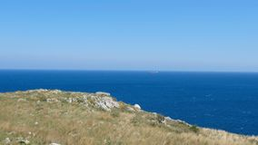 Salento countryside panoramic view panning watchtower coastal seascape grass Apulia Italy stock footage