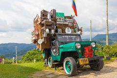 Willys jeep with moving cargo Salento Colombia. Salento March 2018 This Willys Jeep of the 60s is used by Colombian who live in the coffee production area Royalty Free Stock Photography