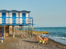 Beach of Salerno with beach huts in background. Campania, Italy. Royalty Free Stock Photo