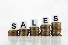 """Sales – Business Concept. A graph of US quarters with the word """"SALES"""" isolated on a white background Stock Photo"""