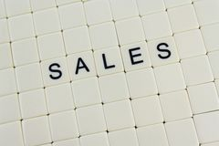 Sales. The word 'sales' spelled out in tiles with bland tiles around it Stock Images