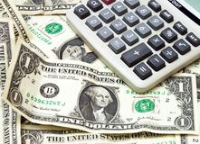 Sales. Close-up view of calculator on layer of money royalty free stock photography
