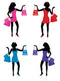 Sales. Silhouettes of women with shopping bags Royalty Free Stock Photo