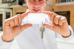 Sales Agent of apartments holds the key in his hand Royalty Free Stock Images