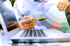 Sales agent choosing color samples for design project. stock image