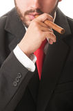 Sales agent smoking a cigar Royalty Free Stock Photography