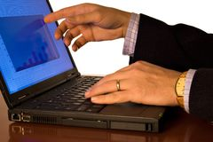 Sales analysis. Hand showing on a computer screen a business graph stock photo