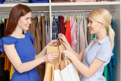 Sales assistant gives bags to the customer Royalty Free Stock Photos
