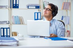 The sales assistant listening to music during lunch break. Sales assistant listening to music during lunch break Royalty Free Stock Photography