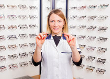 Sales assistant offering modern glasses Stock Photo