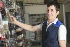 Sales assistant portrait in home appliance shop Stock Image