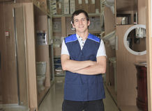 Sales assistant portrait in home appliance shop Royalty Free Stock Image