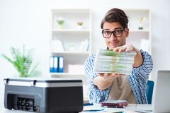 The sales assistant at publishing house showing ready printed books. Sales assistant at publishing house showing ready printed books Stock Photo
