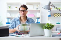 The sales assistant at publishing house showing ready printed books. Sales assistant at publishing house showing ready printed books Stock Image