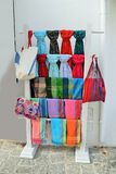 Sales booth with colorful scarfs, mufflers and handbags Stock Photos