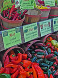 Sales booth with different chilies on a farmer's market Stock Photo
