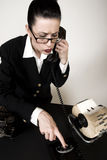 Sales Calls. Retro sales woman making calls on vintage phone Stock Image