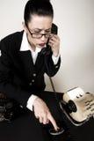 Sales Calls. Retro sales woman making calls on vintage phone stock image