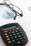Sales chart. Glasses and calculator on a sales chart Royalty Free Stock Photography