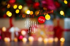 Sales on Christmas and New Year holidays. Blurred Festive decoration with informative inscription of 50 percent discount stock photo