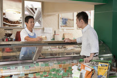 Sales Clerk assisting man at the Deli counter, Beijing Stock Photos