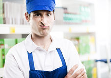 Sales clerk grimacing Stock Photo