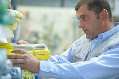 Sales clerk tidying up store Royalty Free Stock Image