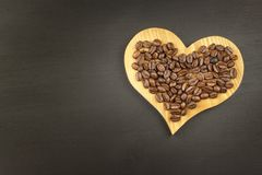 Sales of coffee. Coffee beans on wooden background. Royalty Free Stock Photography