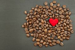 Sales of coffee. Coffee beans on wooden background. Royalty Free Stock Image