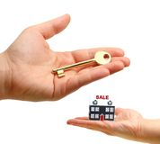 Sales concept. Golden key and house for sale Stock Photos