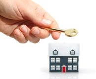 Sales concept. Hand hold a key  and a house for sale ( sales concept Royalty Free Stock Image