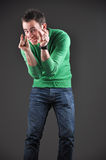 Sales concept, man showing gestures with his hands Royalty Free Stock Photo
