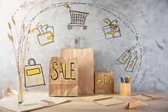 Sales concept. Wooden desktop with shopping bags and other items. Sales concept Royalty Free Stock Photo