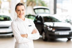 Sales consultant car showroom. Beautiful young sales consultant working in car showroom Stock Photos